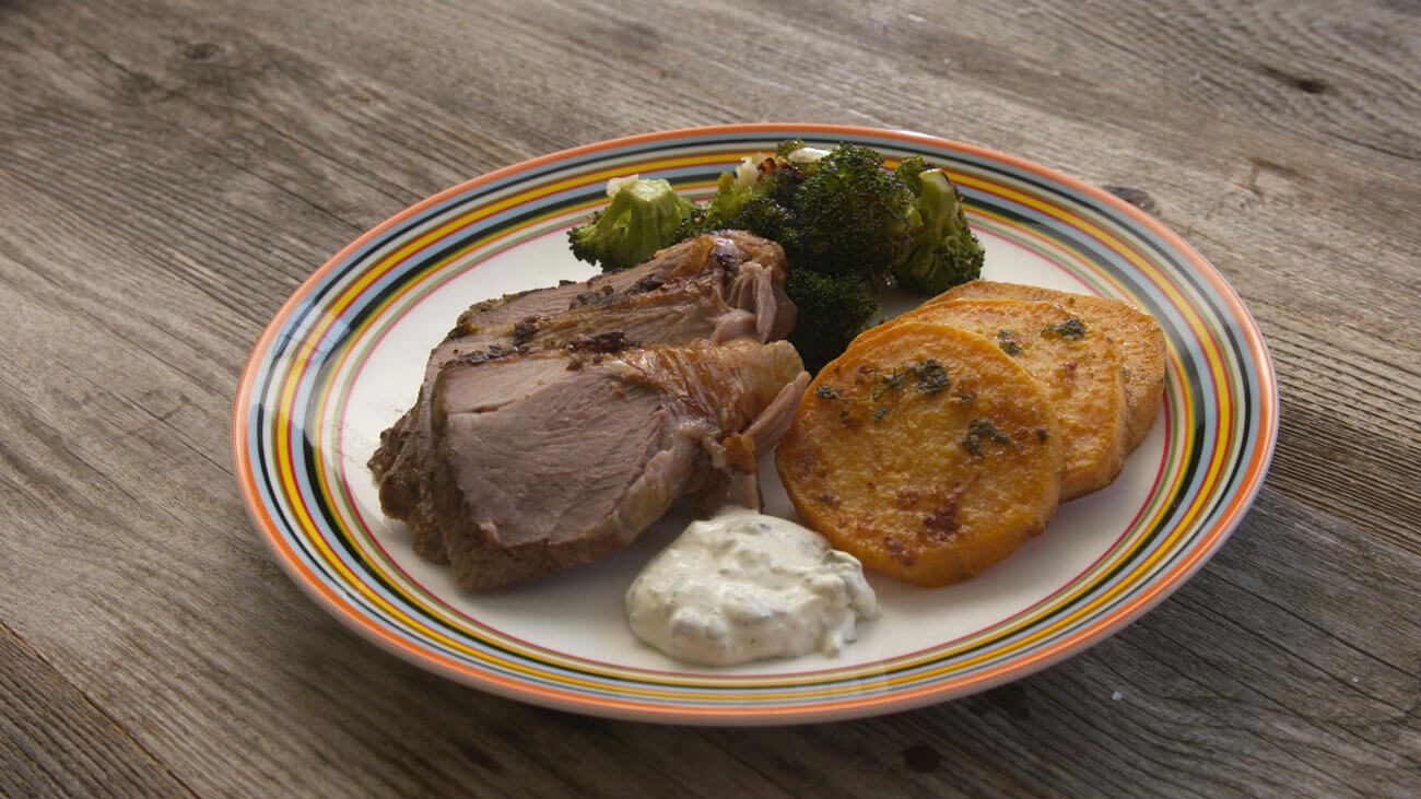 Easter Leg of Lamb on a wooden table