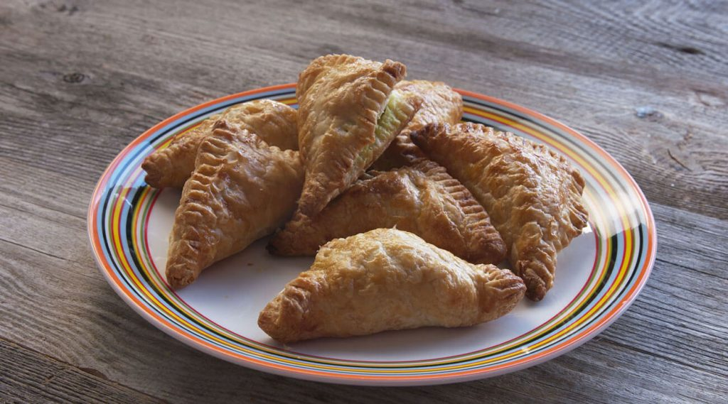 Lamb Pastry Triangles with Feta on a plate