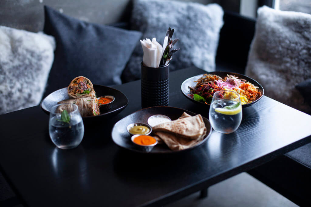 table served with lamb dishes and drinks